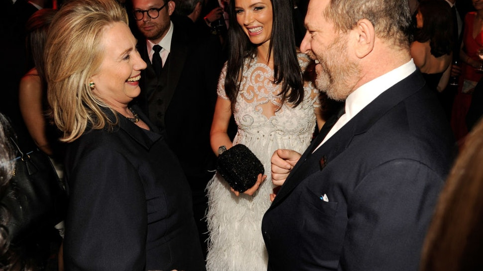 United States Secretary of State Hillary Clinton, Georgina Chapman and Harvey Weinstein attend the TIME 100 Gala celebrating TIME'S 100 Most Infuential People In The World at Jazz at Lincoln Center on April 24, 2012 in New York City.