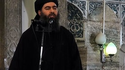 MOSUL, IRAQ - JULY 5 : An image grab taken from a video released on July 5, 2014 by Al-Furqan Media shows alleged Islamic State of Iraq and the Levant (ISIL) leader Abu Bakr al-Baghdadi preaching during Friday prayer at a mosque in Mosul.