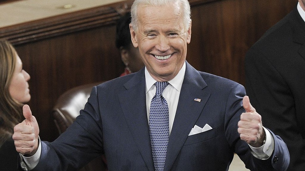 US Vice President Joe Biden gives two thumbs-up prior to US President Barack Obama delivering the State of the Union address before a joint session of Congress on January 28, 2014 at the US Capitol in Washington.