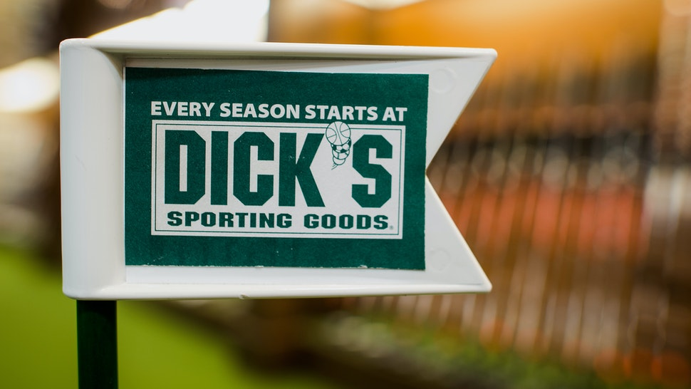 A golf flag stands on a practice green at a Dick's Sporting Goods Inc. store in West Nyack, New York, U.S., on Wednesday, May 21, 2014. Dick's Sporting Goods Inc. shares fell the most in more than a decade after weak sales of golfing and hunting gear crimped its profit forecast. Photographer: Craig Warga/Bloomberg via Getty Images