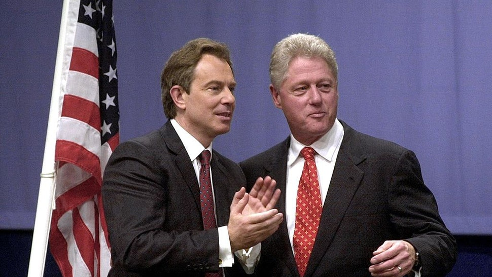 US President Bill Clinton (R) and British Prime Minister Tony Blair stand together 14 December 2000 at Warwick University, near Coventry, where the American leader gave a speech on foreign affairs.
