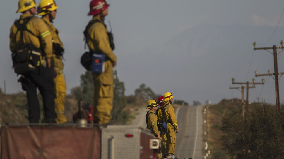 irefighters keep watch at the Blue Cut Fire on August 18, 2016 near Wrightwood, California.. An unknown number of homes and businesses have burned and more than 80,000 people were ordered to evacuate as the wildfire spreads beyond 30,000 acres and threatens to expand into the ski resort town of Wrightwood. (Photo by David McNew/Getty Images)