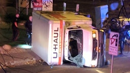 "A rental truck lies on its side in Edmonton, Canada, on October 1, 2017, after a high speed chase. Canadian police arrested a man early Sunday suspected of stabbing an officer and injuring four pedestrians in a series of violent incidents being investigated as an ""act of terrorism."""