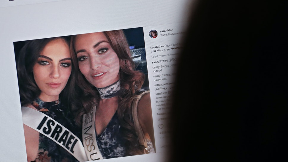 "picture taken on November 21, 2017 shows a picture posted by the Instagram profile of Sarah Idan on November 14, who holds the titles of ""Miss Iraq USA 2016"" and ""Miss Iraq Universe 2017"", as she is seen taking a ""selfie"" photograph with Adar Gandelsman, who holds the title of ""Miss Universe Israel 2017"", with a caption reading: ""Peace and Love from Miss Iraq and Miss Israel #missuniverse""."