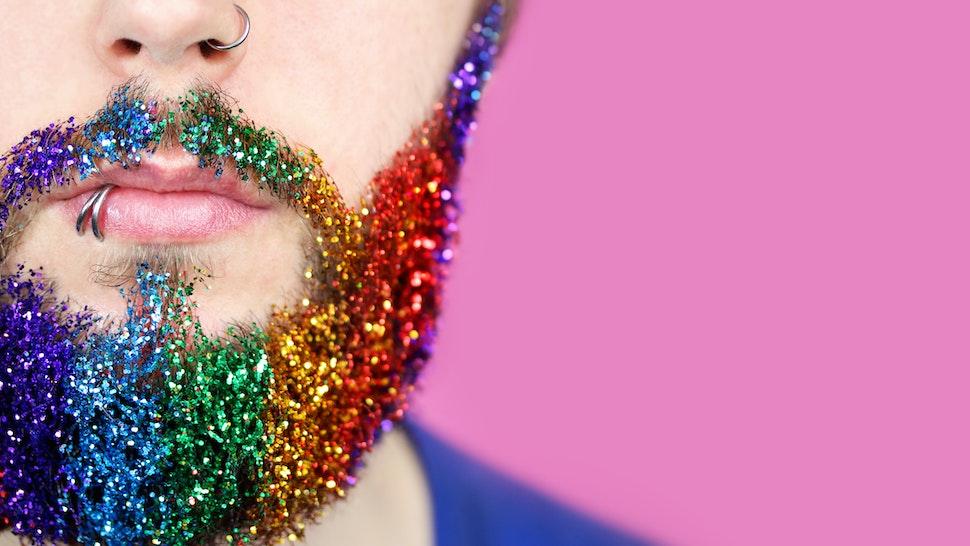 gay pride man with rainbow glitter beard - stock photo