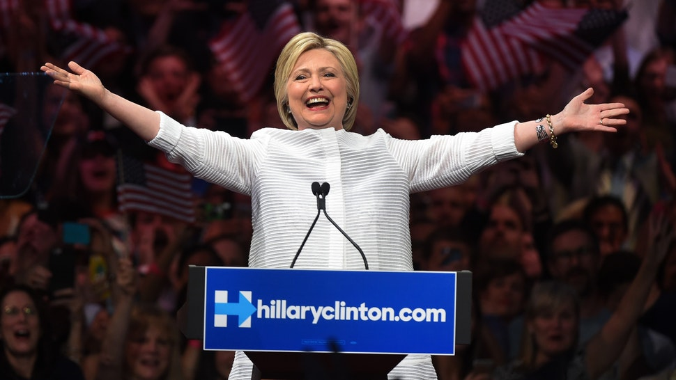 "Democratic presidential candidate Hillary Clinton acknowledges celebratory cheers from the crowd during her primary night event at the Duggal Greenhouse, Brooklyn Navy Yard, June 7, 2016 in New York. Hillary Clinton hailed a historical ""milestone"" for women as she claimed victory over rival Bernie Sanders in the Democratic White House nomination race."