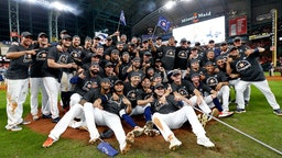 The Houston Astros pose for a photo as they celebrate their 6-4 win against the New York Yankees in game six of the American League Championship Series at Minute Maid Park on October 19, 2019 in Houston, Texas. (Photo by Elsa/Getty Images)