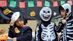 Schoolchildren wear masks and present many varieties of ghoulish characters during a costume party to celebrate Halloween at Taman Rama International School in Jimbaran on the resort island of Bali on October 30, 2009. Halloween, which falls annually on October 31, is widely celerated amongst the expatriate community in Indonesia as part of an effort to recreate traditions from their homes.