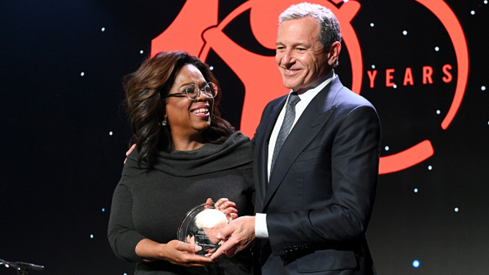 BEVERLY HILLS, CALIFORNIA - OCTOBER 02: Centennial Award Honoree, Robert A. Iger accepts the award from Oprah Winfrey onstage during the Save The Children's Centennial Celebration: Once in a Lifetime at The Beverly Hilton Hotel on October 02, 2019 in Beverly Hills, California.
