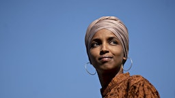 Ilhan Omar listens during a news conference on the Zero Waste Act