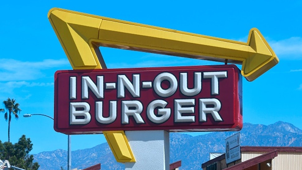 The signs points to an In-N-Out Burger restaurant in Alhambra, California on August 30, 2018. - Califoria's Democratic Party Chairman, Eric Bauman, is calling for a boycott of the Irvine, CA based fast food chain after it donated $25,000 to help California Republicans in November. In addition to this week's donation, In-N-Out donated $30,000 to the GOP in 2017 and 2016.