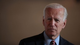 Joe Biden speaks to guests during a campaign stop at the Small Grand Things event center