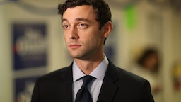 Jon Ossoff visits a campaign office to speak with volunteers and supporters on Election Day