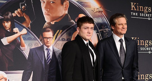 """Taron Egerton (L) and Colin Firth attend the """"Kingsman: The Secret Service"""" New York premiere at SVA Theater on February 9, 2015 in New York City."""