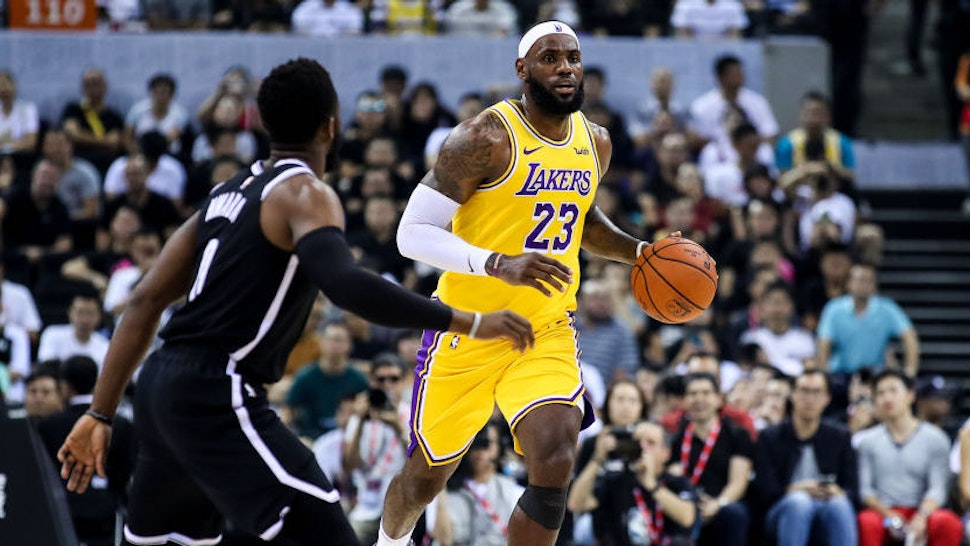 #23 LeBron James of Los Angeles Lakers drives the ball during NBA China Games 2019 between Los Angeles Lakers and Brooklyn Nets at Shenzhen Universiade Center on October 12, 2019 in Shenzhen, China. NOTE TO USER: User expressly acknowledges and agrees that, by downloading and/or using this photograph, user is consenting to the terms and conditions of the Getty Images License Agreement. (Photo by Zhizhao Wu/Getty Images)