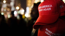 """""""Make America Great Again"""" red baseball caps, signature headwear of the Donald Trump campaign and its supporters, stand on sale on 6th Avenue in Midtown Manhattan in the second hour after Election Day as election results point to a shock Trump win. (Photo by David Cliff/SOPA Images/LightRocket via Getty Images)"""
