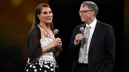 NEW YORK, NY - MAY 14: Melinda Gates and Bill Gates speak on stage during The Robin Hood Foundation's 2018 benefit at Jacob Javitz Center on May 14, 2018 in New York City.