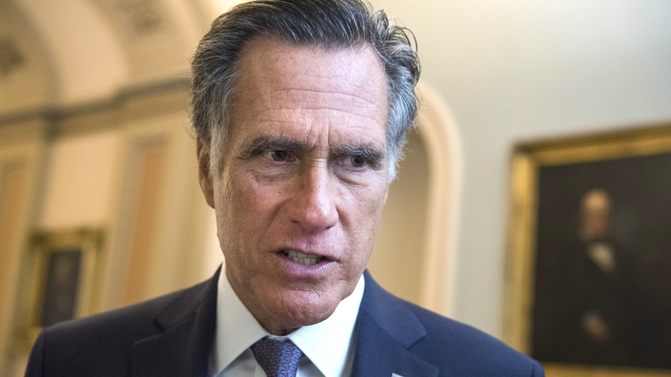 Sen. Mitt Romney, R-Utah, talks with reporters after a vote in the Capitol on Thursday, September 12, 2019.