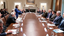 "WASHINGTON, DC - OCTOBER 16: In this handout provided by the White House, U.S. President Donald Trump meets with House Speaker Nancy Pelosi and Congressional leadership in the Cabinet Room of the White House October 16, 2019 in Washington, DC. Pelosi later said Trump referred to her as a ""third-grade politician."