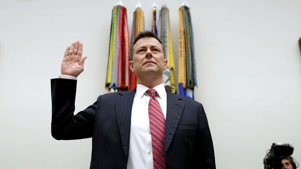 Deputy Assistant FBI Director Peter Strzok is sworn in before a joint committee hearing of the House Judiciary and Oversight and Government Reform committees in the Rayburn House Office Building on Capitol Hill July 12, 2018 in Washington, DC. While involved in the probe into Hillary ClintonÕs use of a private email server in 2016, Strzok exchanged text messages with FBI attorney Lisa Page that were critical of Trump. After learning about the messages, Mueller removed Strzok from his investigation into whether the Trump campaign colluded with Russia to win the 2016 presidential election. (Photo by Chip Somodevilla/Getty Images)