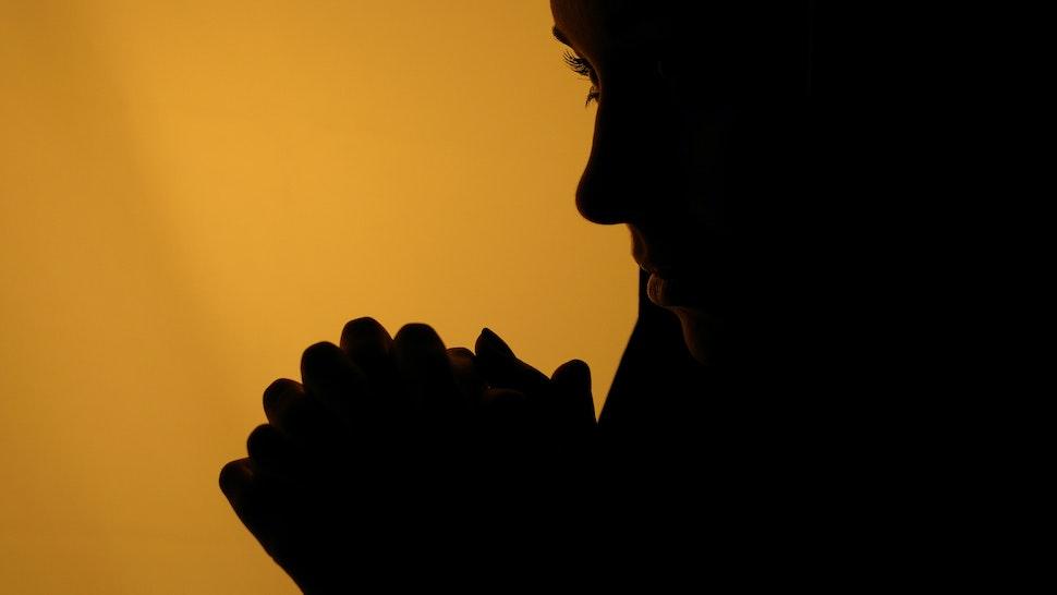 Woman in a prayer position, Kiev, Ukraine