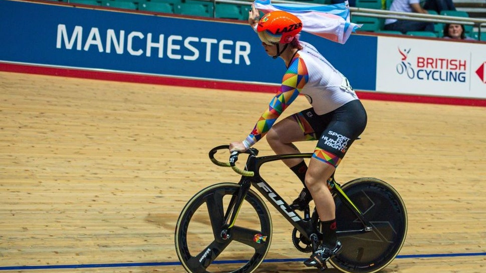 Canadian cyclist Rachel McKinnon carries a Transgender Pride flag as she celebrates winning the F35-39 Sprint Final during the 2019 UCI Track Cycling World Masters Championship, in Manchester on October 19, 2019. - Transgender cyclist Rachel McKinnon has defended her right to compete in women's sport despite accepting trans athletes may retain a physical advantage over their rivals. (Photo by OLI SCARFF / AFP) (Photo by OLI SCARFF/AFP via Getty Images