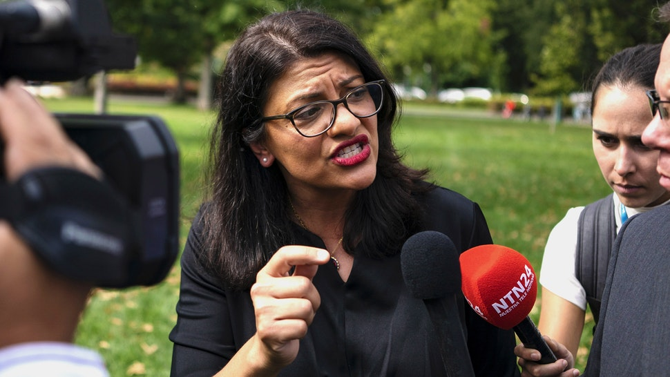 Representative Rashida Tlaib, a Democrat from Michigan, speaks with members of the media following a rally held in support of impeaching U.S. President Donald Trump in Washington, D.C., U.S., on Thursday, Sept. 26, 2019. House Speaker Nancy Pelosi announced that the House would begin an impeachment inquiry against Trump related to a whistle-blower complaint alleging troubling interactions between Trump and the president of Ukraine.