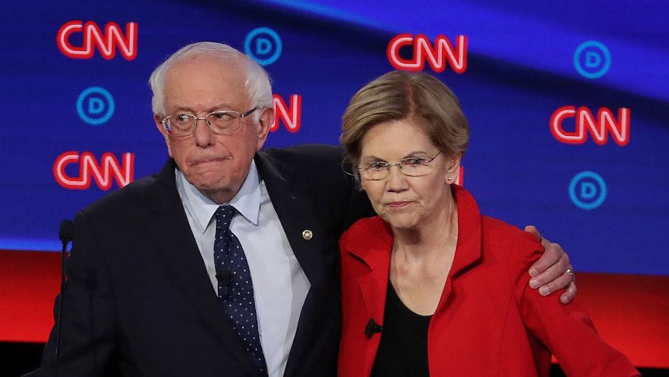 Sen. Bernie Sanders and Sen. Elizabeth Warren embrace after the Democratic Presidential Debate