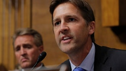 WASHINGTON D.C - SEPTEMBER 27: U.S. Senator Ben Sasse (R-NE) questions Judge Brett Kavanaugh as Senator Jeff Flake (R-AZ) looks on during Kavanaugh's testimony before the Senate Judiciary Committee during his Supreme Court confirmation hearing in the Dirksen Senate Office Building on Capitol Hill September 27, 2018 in Washington, DC.