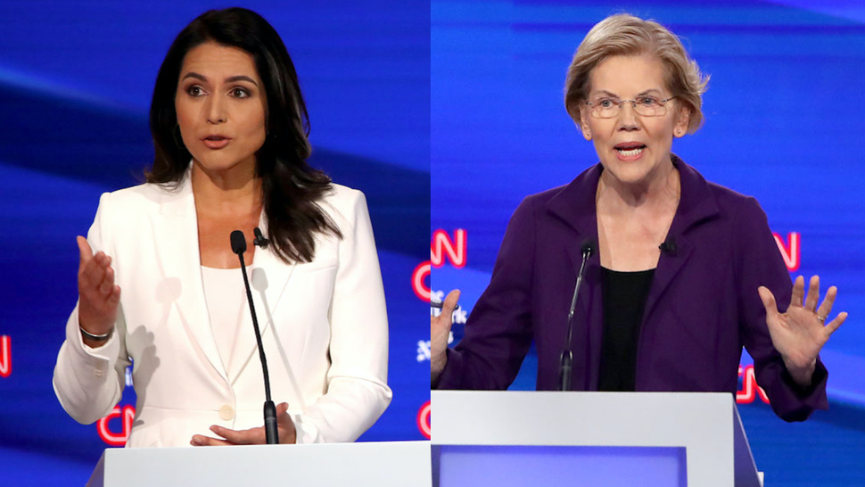 Rep. Tulsi Gabbard (D-HI) and Sen. Elizabeth Warren (D-MA) speak during the Democratic Presidential Debate at Otterbein University on October 15, 2019 in Westerville, Ohio.