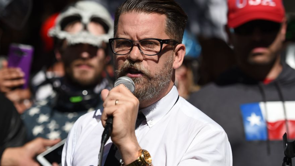 Vice Media co-founder and conservative speaker Gavin McInnes reads a speech written by Ann Coulter to a crowd during a conservative rally in Berkeley, California on April 27, 2017.