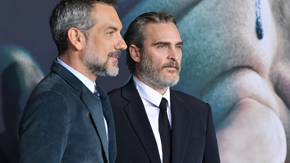 """HOLLYWOOD, CALIFORNIA - SEPTEMBER 28: Todd Phillips and Joaquin Phoenix attend the premiere of Warner Bros Pictures """"Joker"""" on September 28, 2019 in Hollywood, California."""