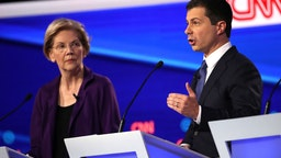 Sen. Elizabeth Warren looks on as South Bend, Indiana Mayor Pete Buttigieg speaks during the Democratic Presidential Debate