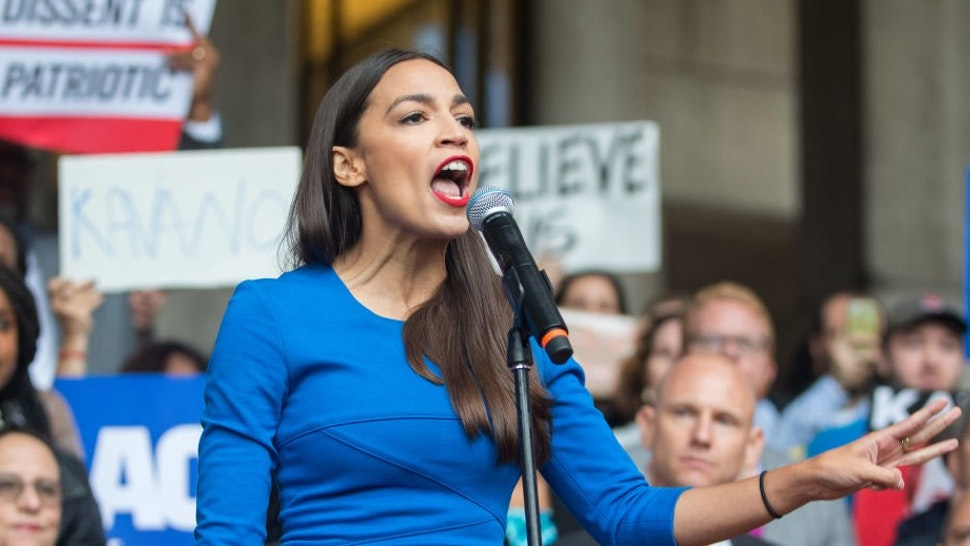 BOSTON, MA - OCTOBER 01: New York Democratic congressional candidate Alexandria Ocasio-Cortez speaks at a rally calling on Sen. Jeff Flake (R-AZ) to reject Judge Brett Kavanaugh's nomination to the Supreme Court on October 1, 2018 in Boston, Massachusetts. Sen. Flake is scheduled to give a talk at the Forbes 30 under 30 event in Boston after recently calling for a one week pause in the confirmation process to give the FBI more time to investigate sexual assault allegations.