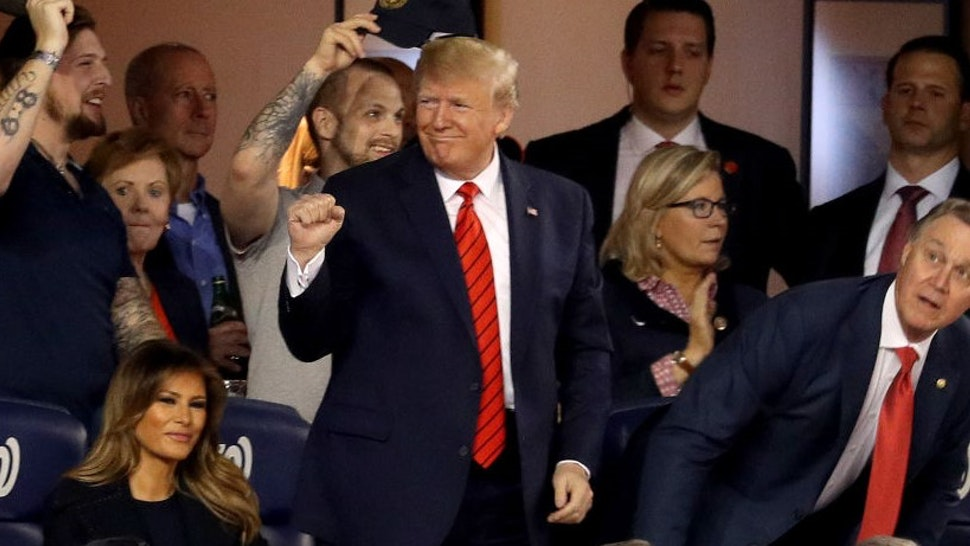 President Donald Trump attends Game Five of the 2019 World Series between the Houston Astros and the Washington Nationals at Nationals Park on October 27, 2019 in Washington, DC. (Photo by Will Newton/Getty Images)
