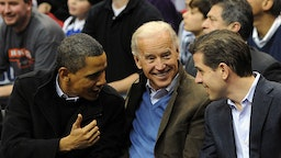 U.S. President Barack Obama (L) greets Vice President Joe Biden (C) and his son Hunter Biden as they attend the game between the Duke Blue Devils and Georgetown Hoyas on January 30, 2010 at the Verizon Center in Washington, DC. (Photo by Alexis C. Glenn-Pool/Getty Images