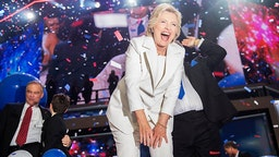 Democratic presidential nominee Hillary Clinton and her running mate Tim Kaine, left, celebrate at the Wells Fargo Center in Philadelphia, Pa., on the final night of the Democratic National Convention, July 28, 2016. (Photo By Tom Williams/CQ Roll Call)