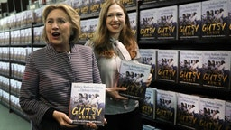 "Chelsea and Hillary Clinton pose with their new book ""The Book of Gutsy Women"" on October 03, 2019 in New York City. The new book by mother and daughter co-authors celebrates women in history, many of whom have been overlooked, that have stood up to adversity. (Photo by Spencer Platt/Getty Images)"