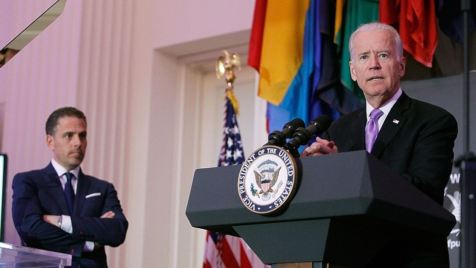 U.S. Vice President Joe Biden (R) speaks as his son, Hunter Biden, looks on at the World Food Program USA's Annual McGovern-Dole Leadership Award Ceremony at Organization of American States on April 12, 2016 in Washington, DC. (Photo by Paul Morigi/Getty Images for World Food Program USA)
