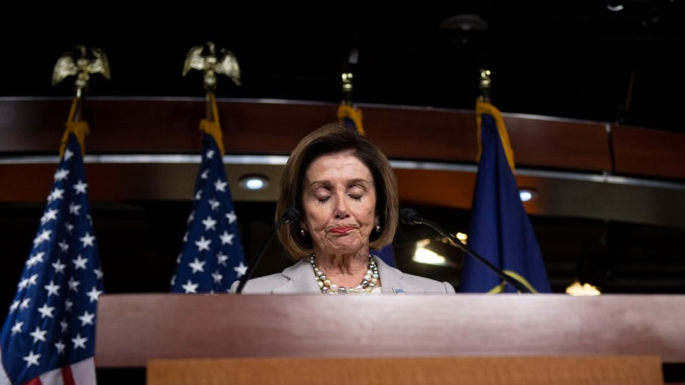 House Speaker Nancy Pelosi of Calif., pauses while speaking about the recent passing of Rep. Elijah Cummings, during a news conference on Capitol Hill in Washington on Thursday, Oct. 17, 2019. (Photo by Caroline Brehman/CQ-Roll Call, Inc via Getty Images)