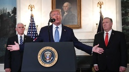 US President Donald Trump speaks about Syria in the Diplomatic Reception Room at the White House in Washington, DC, October 23, 2019 as US Vice President Mike Pence(L) and US Secretary of State Mike Pompeo look on. - President Donald Trump announced on Wednesday the United States would be lifting sanctions on Turkey,