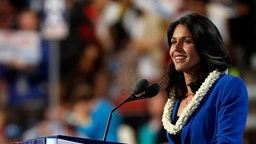 US representative Tulsi Gabbard (D-HI) delivers remarks on the second day of the Democratic National Convention at the Wells Fargo Center, July 26, 2016 in Philadelphia, Pennsylvania. An estimated 50,000 people are expected in Philadelphia, including hundreds of protesters and members of the media. The four-day Democratic National Convention kicked off July 25. (Photo by Aaron P. Bernstein/Getty Images)