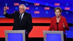 Democratic presidential hopeful US Senator from Massachusetts Elizabeth Warren (R) speaks next to US senator from Vermont Bernie Sanders during the first round of the second Democratic primary debate of the 2020 presidential campaign season hosted by CNN at the Fox Theatre in Detroit, Michigan on July 30, 2019.