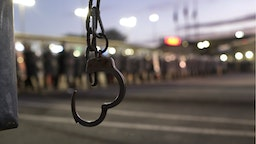 A handcuff attached to a fence is seen as U.S. Customs and Border Protection (CBP) officers block the Otay Mesa port of entry from Mexico into the United States early on December 1, 2018 as seen from Tijuana, Mexico.