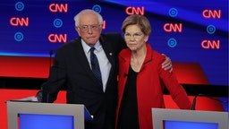 Democratic presidential candidate Sen. Bernie Sanders (I-VT) (L) and Sen. Elizabeth Warren (D-MA) embrace after the Democratic Presidential Debate at the Fox Theatre July 30, 2019 in Detroit, Michigan.