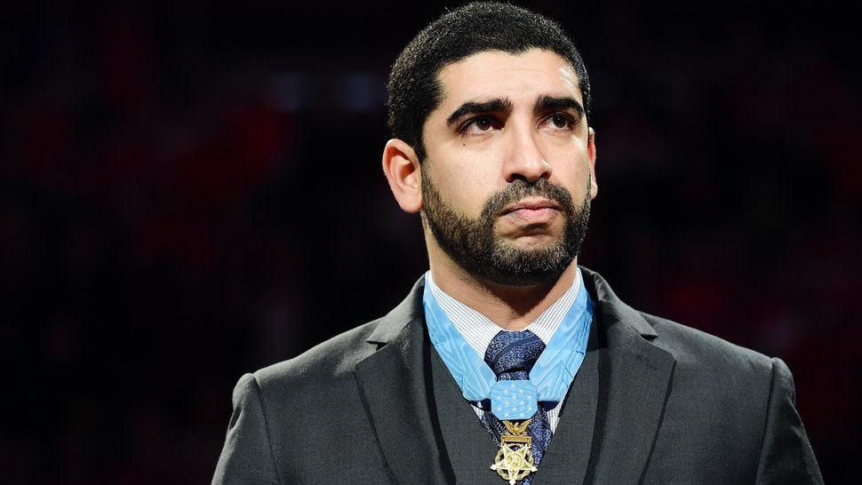 Medal of Honor recipient retired U.S. Army Capt. Florent 'Flo' Groberg takes part in a ceremonial puck drop before the start of an NHL game between the New Jersey Devils and Washington Capitals at Verizon Center on March 2, 2017 in Washington, DC.