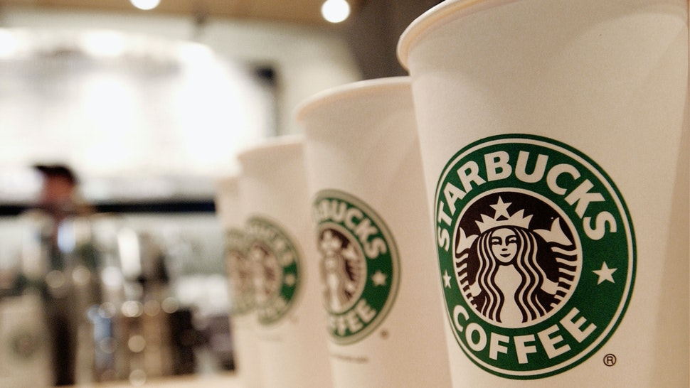 Beverage cups featuring the logo of Starbucks Coffee are seen in the new flagship store on 42nd Street August 5, 2003 in New York City.