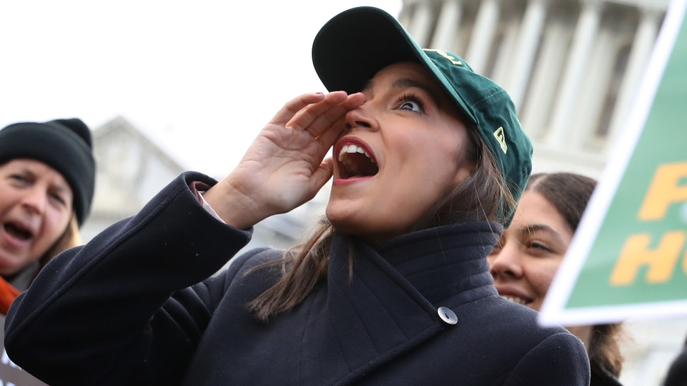 WASHINGTON, DC - NOVEMBER 14: Rep. Alexandria Ocasio-Cortez (D-NY) (2nd L) chants with housing and environmental advocates before a news conference to introduce legislation to transform public housing as part of her Green New Deal outside the U.S. Capitol November 14, 2019 in Washington, DC. The liberal legislators invited affordable housing advocates and climate change activists to join them for the announcement.