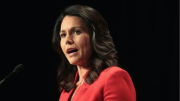 Democratic presidential candidate and Hawaii congresswoman Tulsi Gabbard speaks at the Iowa Democratic Party's Hall of Fame Dinner on June 9, 2019 in Cedar Rapids, Iowa.