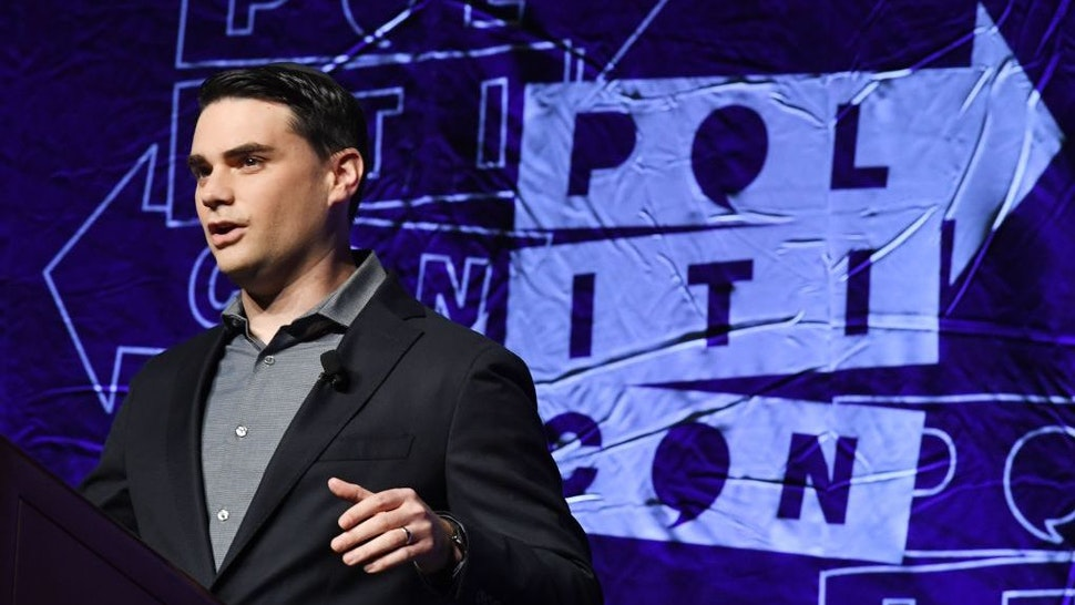 Conservative political commentator, writer and lawyer Ben Shapiro waves to the crowd as he arrives to speak at the 2018 Politicon in Los Angeles, California on October 21, 2018. - The two day event covers all things political with dozens of high profile political figures. (Photo by Mark RALSTON / AFP) (Photo credit should read MARK RALSTON/AFP via Getty Images)